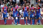 Wilfried Zaha, centre, celebrates his clinching goal with team-mates
