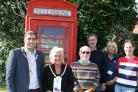 Cllrs Riaz and Morgan visit the phone box with charity supporters.