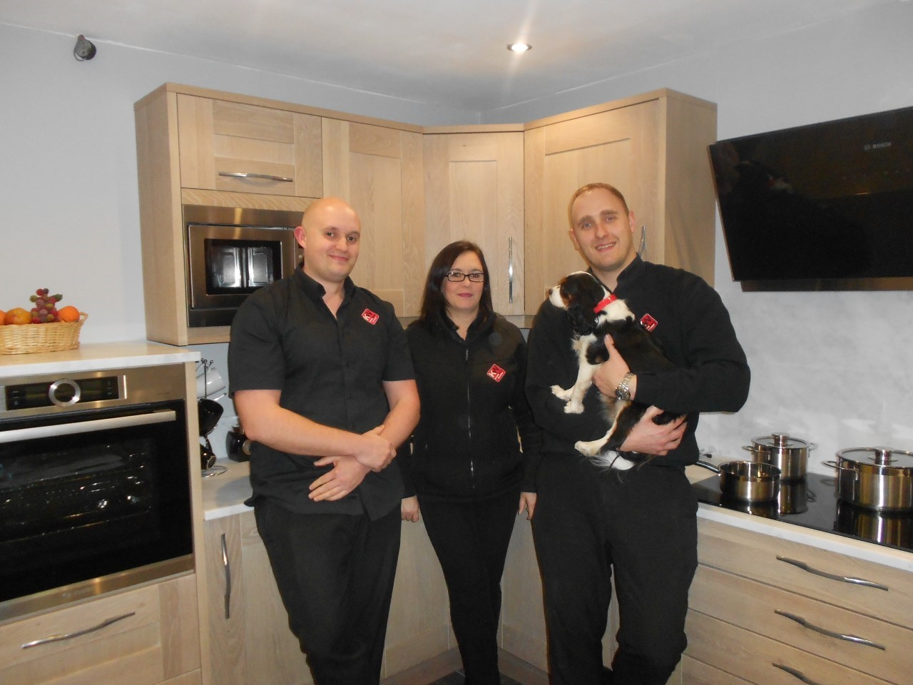 FAMILY: Hayley Sherwood and the team from Kitchen World