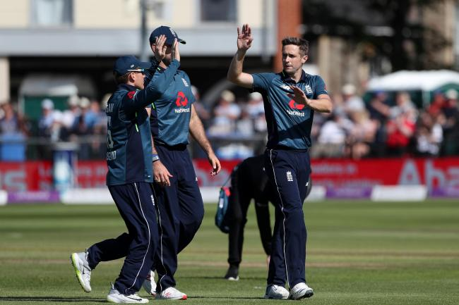 England's Chris Woakes (right) celebrates taking the wicket of Pakistan batsman Asif Ali at Bristol on Tuesday