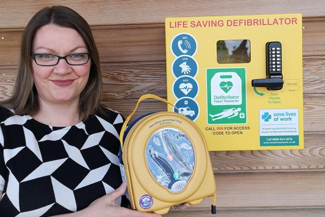 Joy Edgington, Manager of Wyre Forest Crematorium, with the defibrillator.