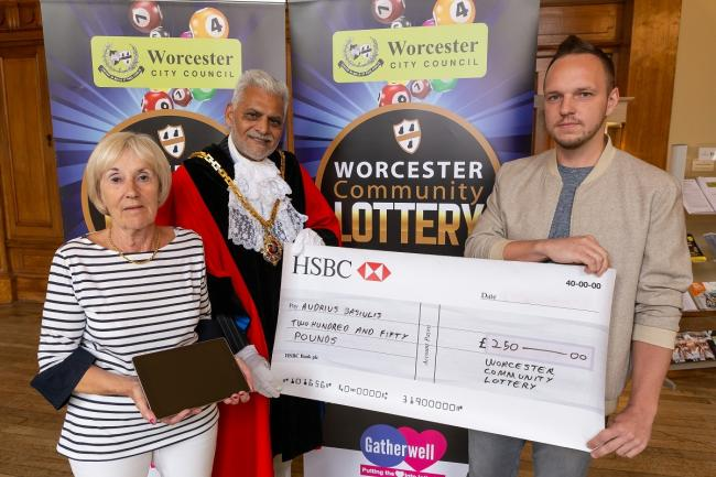 LUCKY: Mayor of Worcester, Cllr Allah Ditta, presents Rosemary Goddard (left) and Audrius Basiulis with their prizes